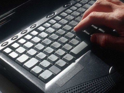 Hand at computer